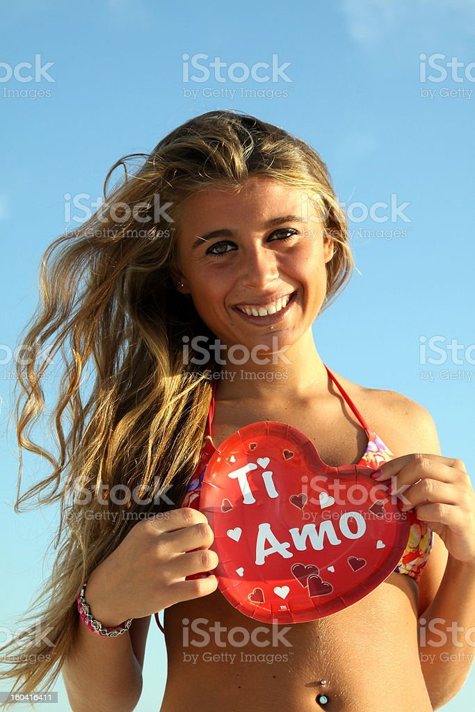 girl declares her love with heart in hand stock photo
