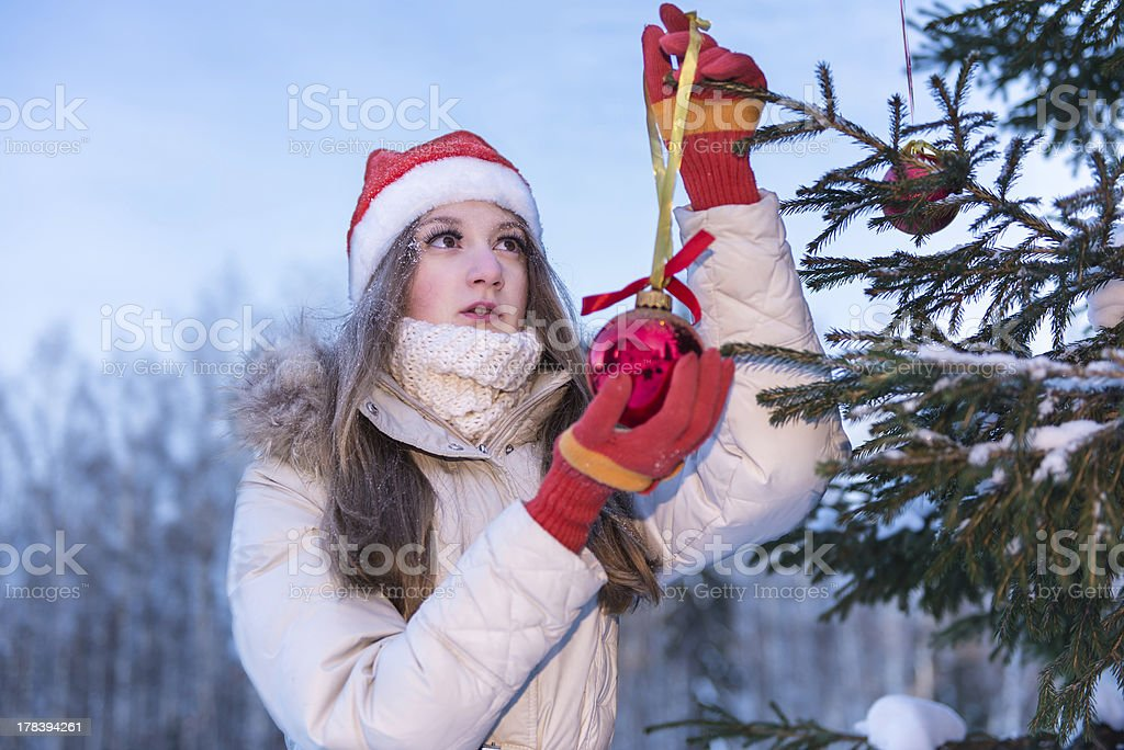 Girl decorating christmass tree royalty-free stock photo