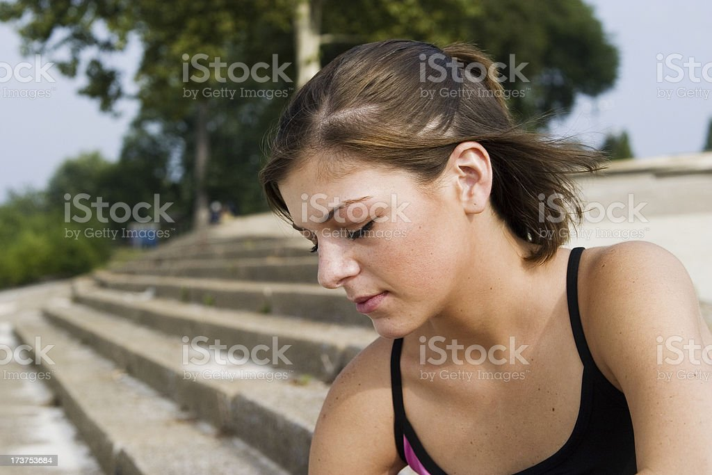 Girl deep in thought stock photo