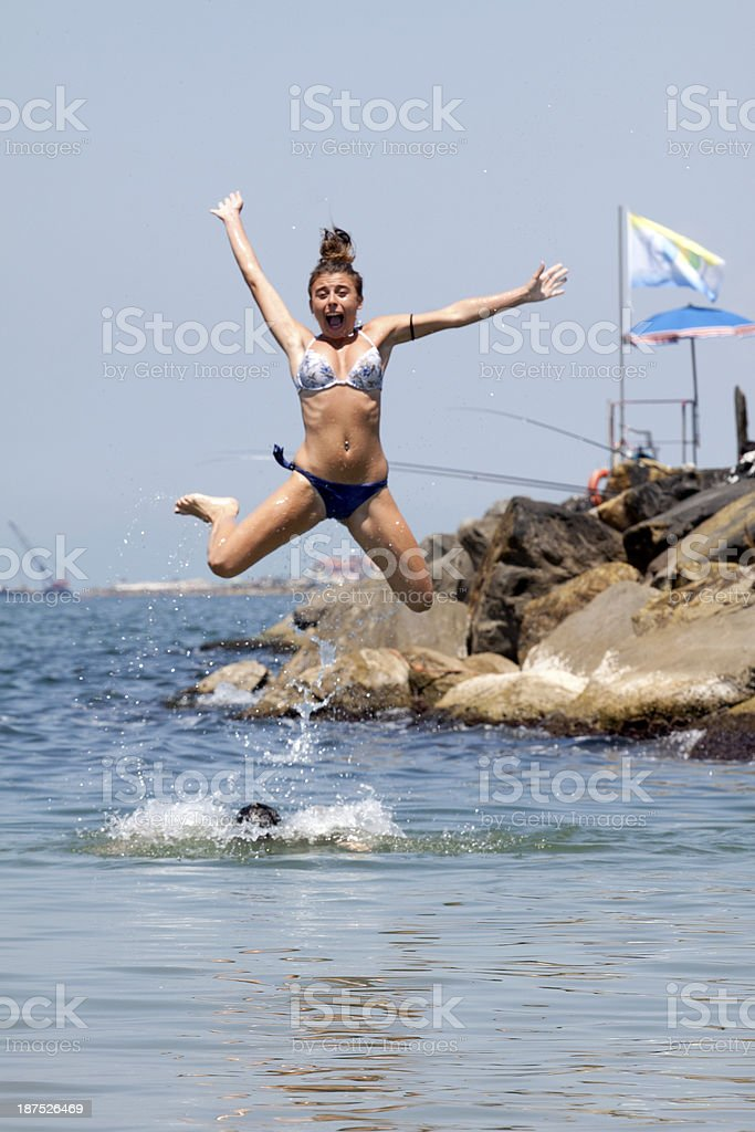 girl dip in the sea stock photo