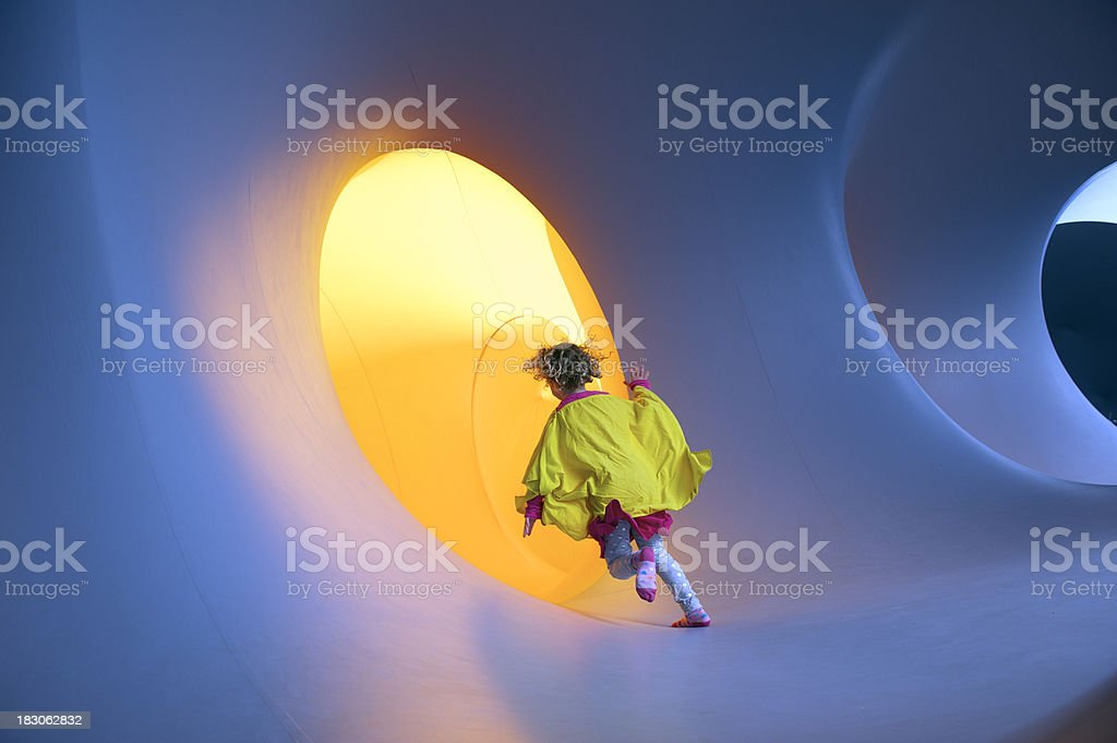 Girl disappearing into a yellow tunnel royalty-free stock photo