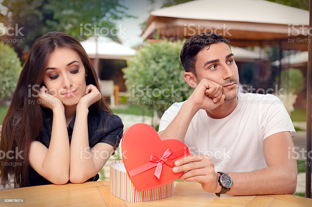 Girl Disappointed on Her Valentine Gift From Boyfriend stock photo