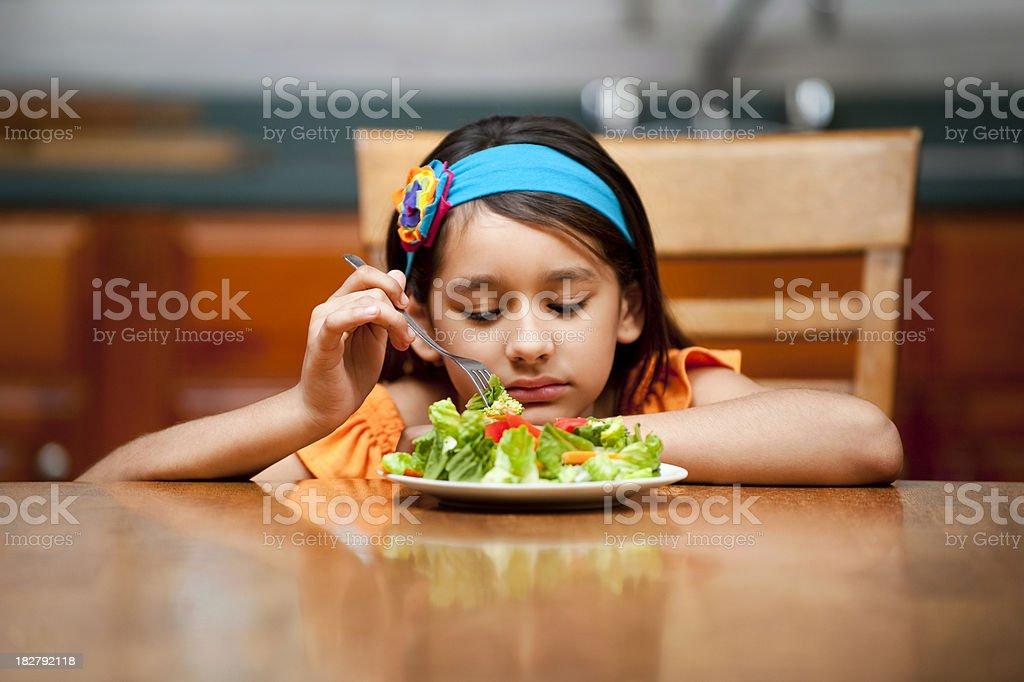 Girl disliking her food stock photo