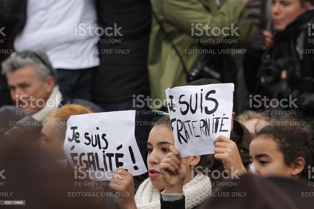 Girl displaying slogan defending freedom and equality in Paris stock photo