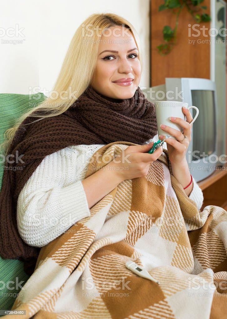 Girl dissolving medicine in glass stock photo