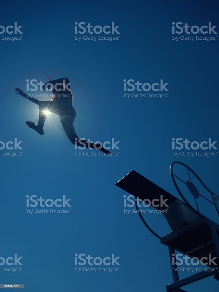 girl diving to sea stock photo