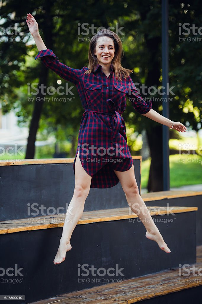 Girl does pirouette walking on a tiptoes against summer park. stock photo
