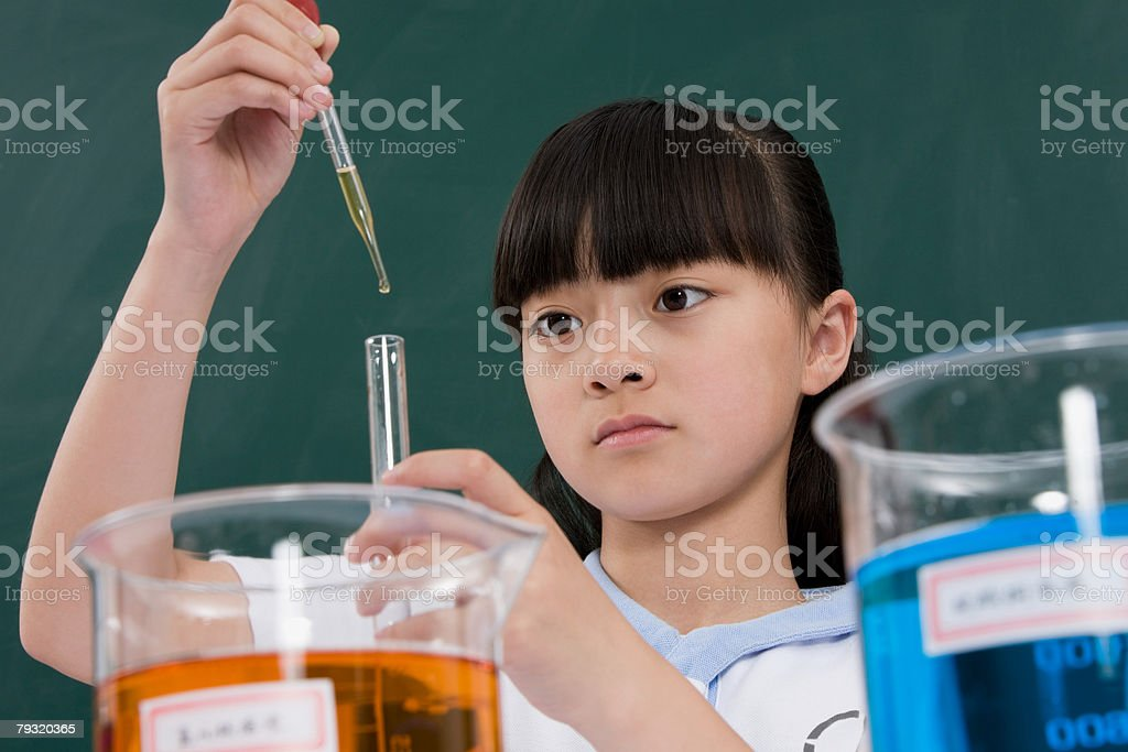 A girl doing a science experiment royalty-free stock photo