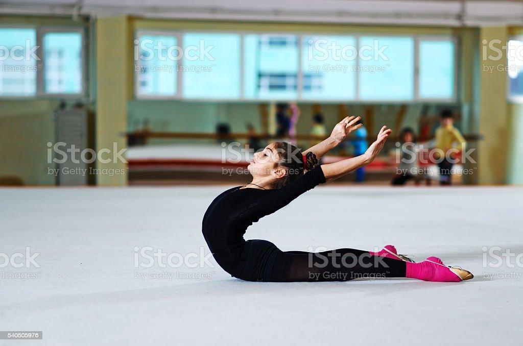 Girl doing backfold  training stock photo