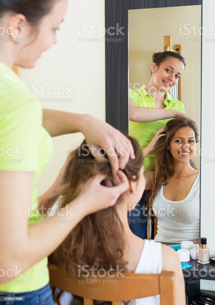 Girl doing hairstyle stock photo