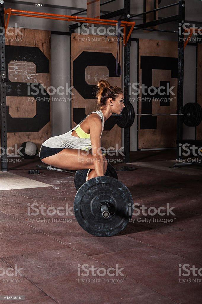 girl doing heavy  deadlift exercise stock photo