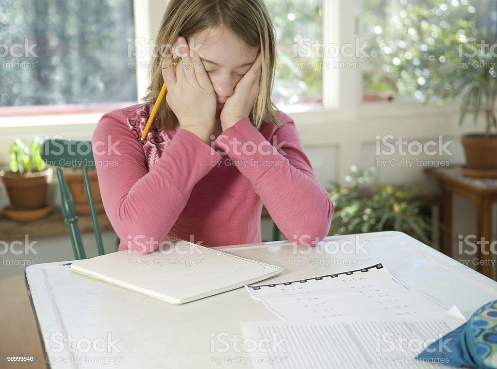 Girl doing homework - frustrated royalty-free stock photo