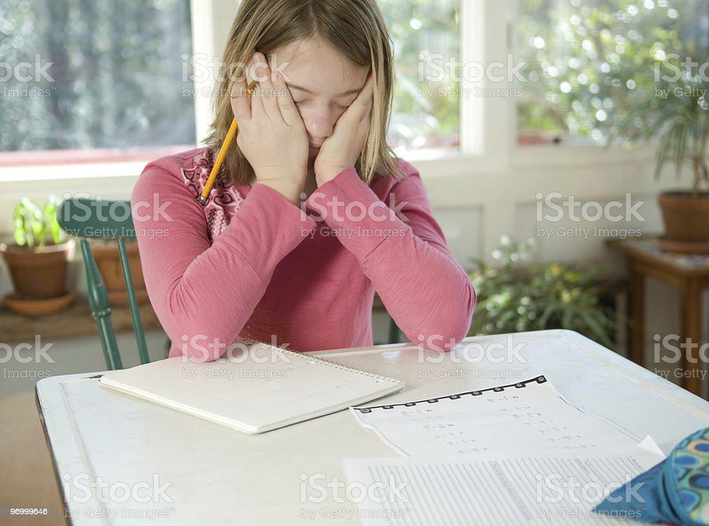 Girl doing homework - frustrated stock photo