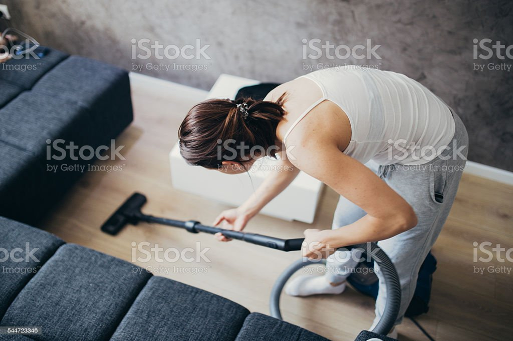 Girl doing house work stock photo