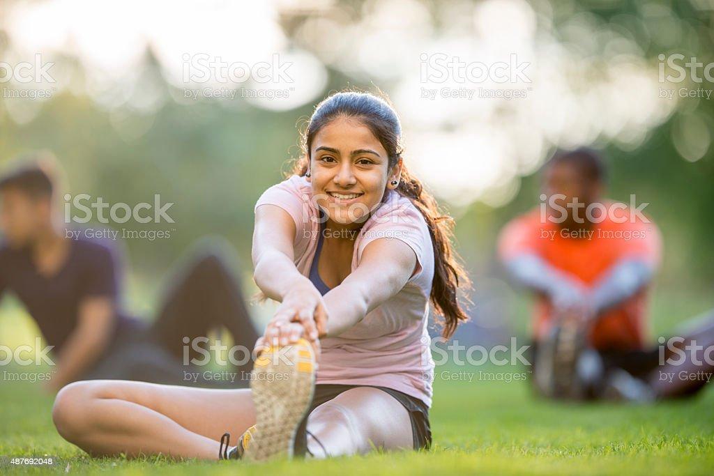 Girl Doing Leg Stretches stock photo