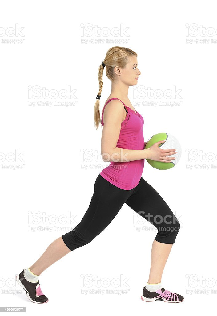 Girl doing lunges exercise with medicine ball stock photo