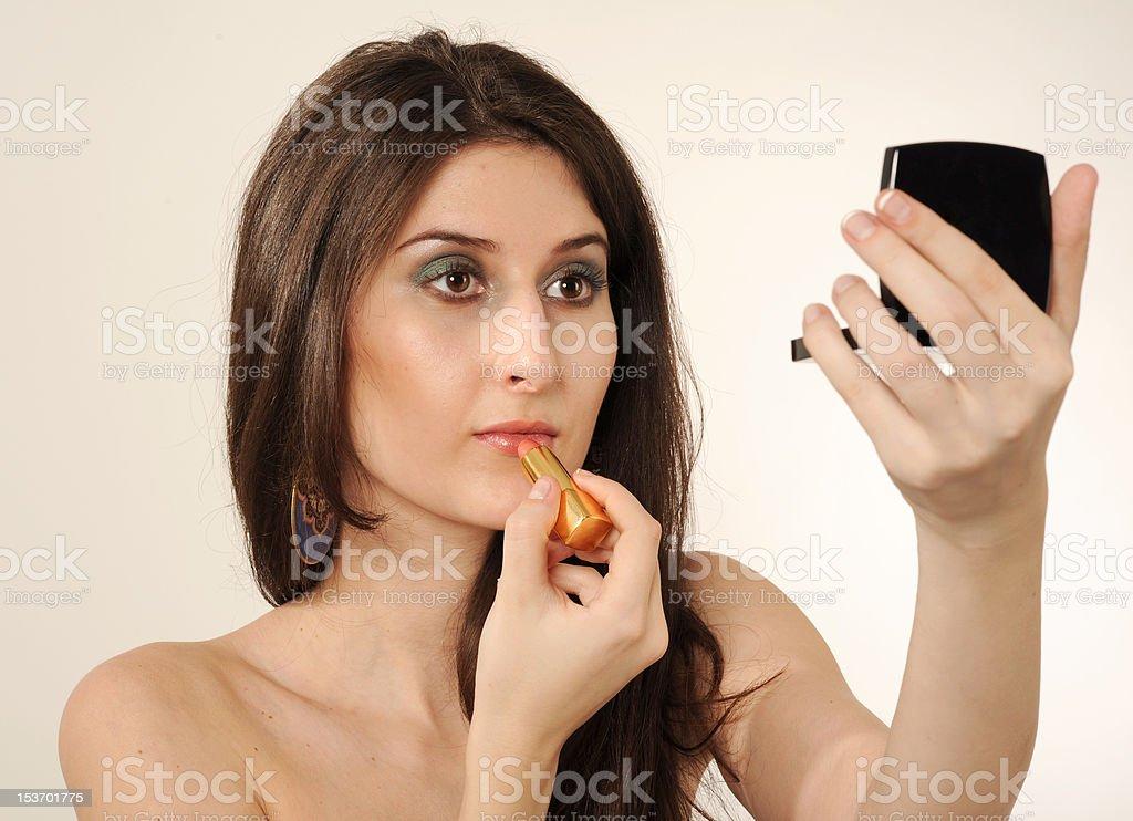Femme faisant de maquillage photo libre de droits
