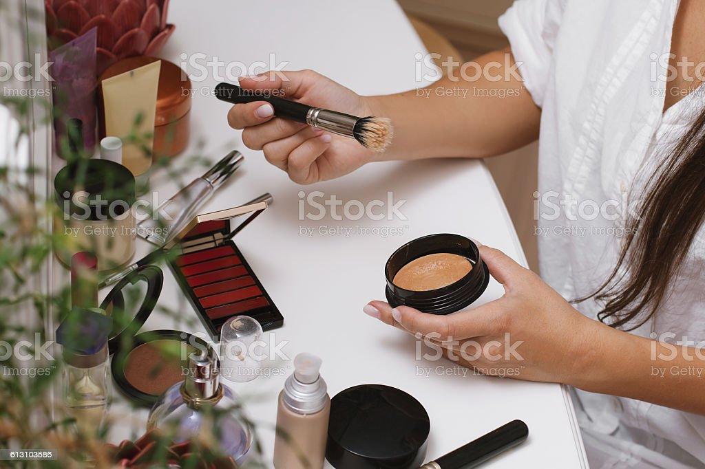 Girl doing makeup. stock photo