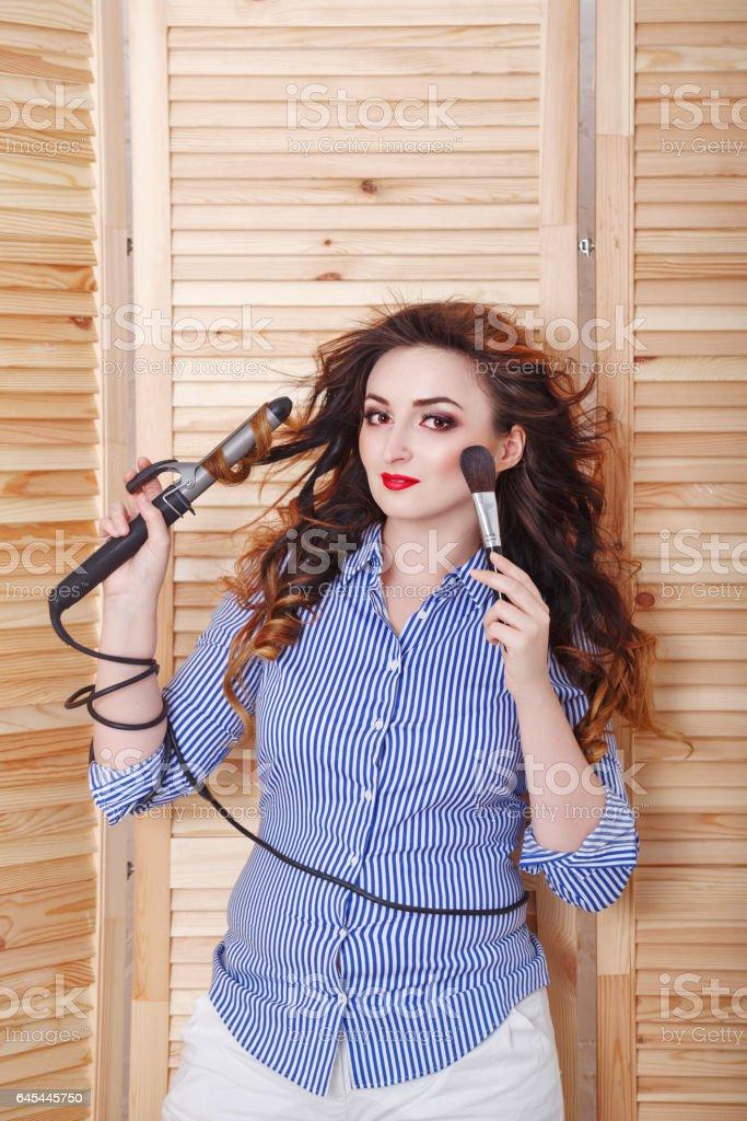 Girl doing morning makeup. stock photo