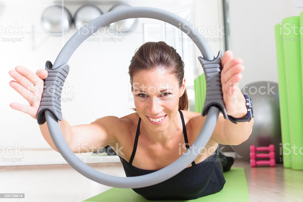 girl doing pilates with ring stock photo