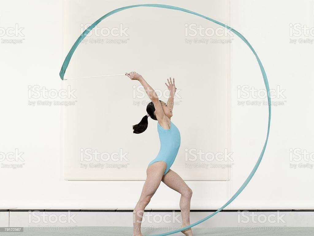 Girl doing rhythmic gymnastics stock photo