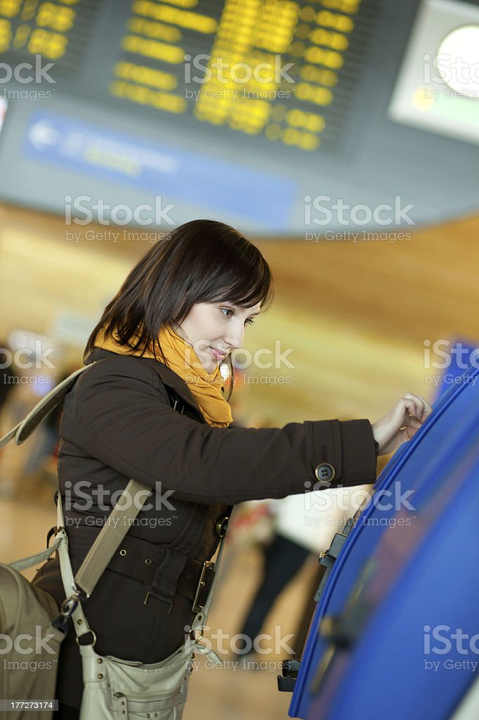Girl doing self-checkin in the airport royalty-free stock photo