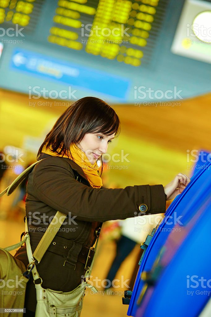 Girl doing self-checkin in the airport stock photo