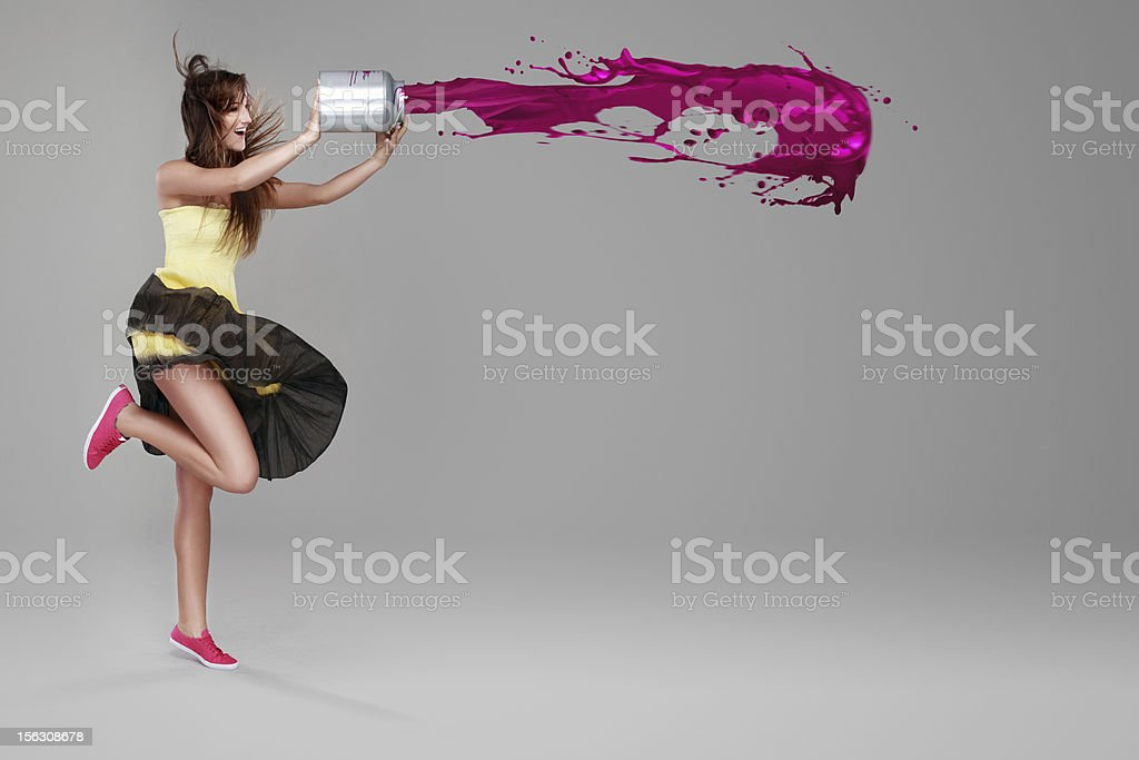 Girl doing splash with a bucket of paint stock photo