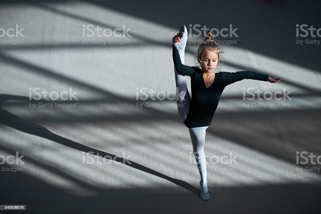 girl doing stretching in gymnastics stock photo