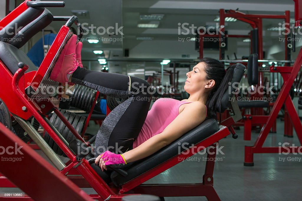 Girl doing the leg press stock photo