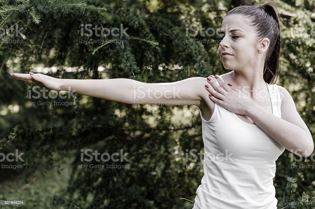girl doing yoga exercises in nature stock photo