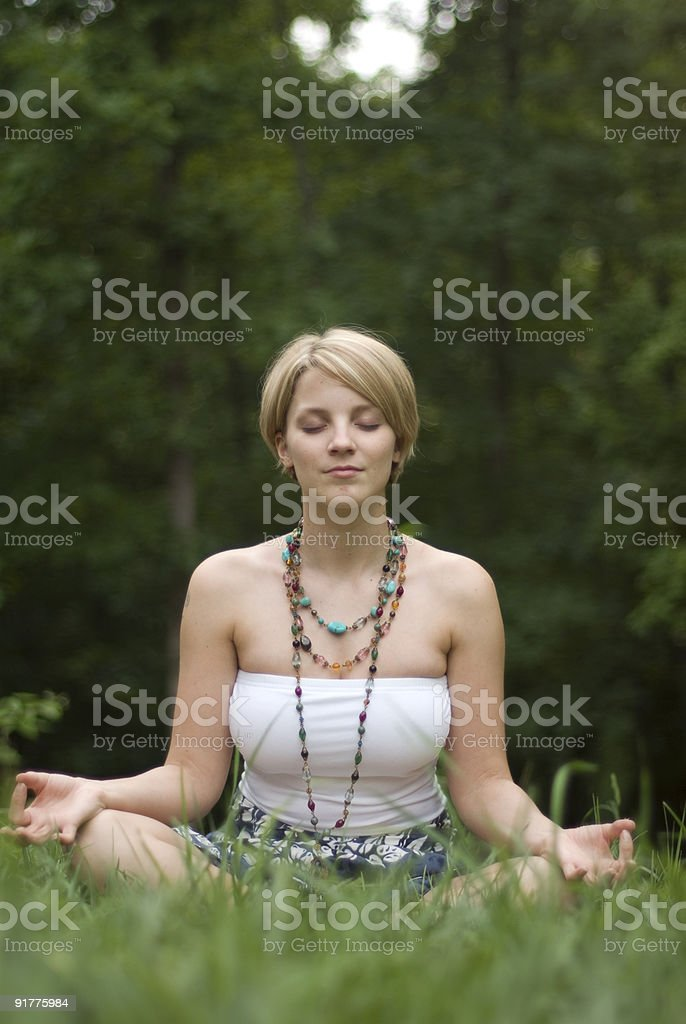 Girl doing Yoga in a Park royalty-free stock photo