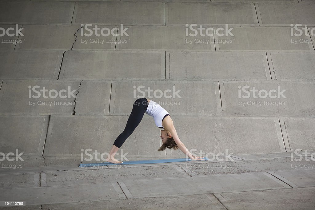 Girl doing yoga on cement royalty-free stock photo