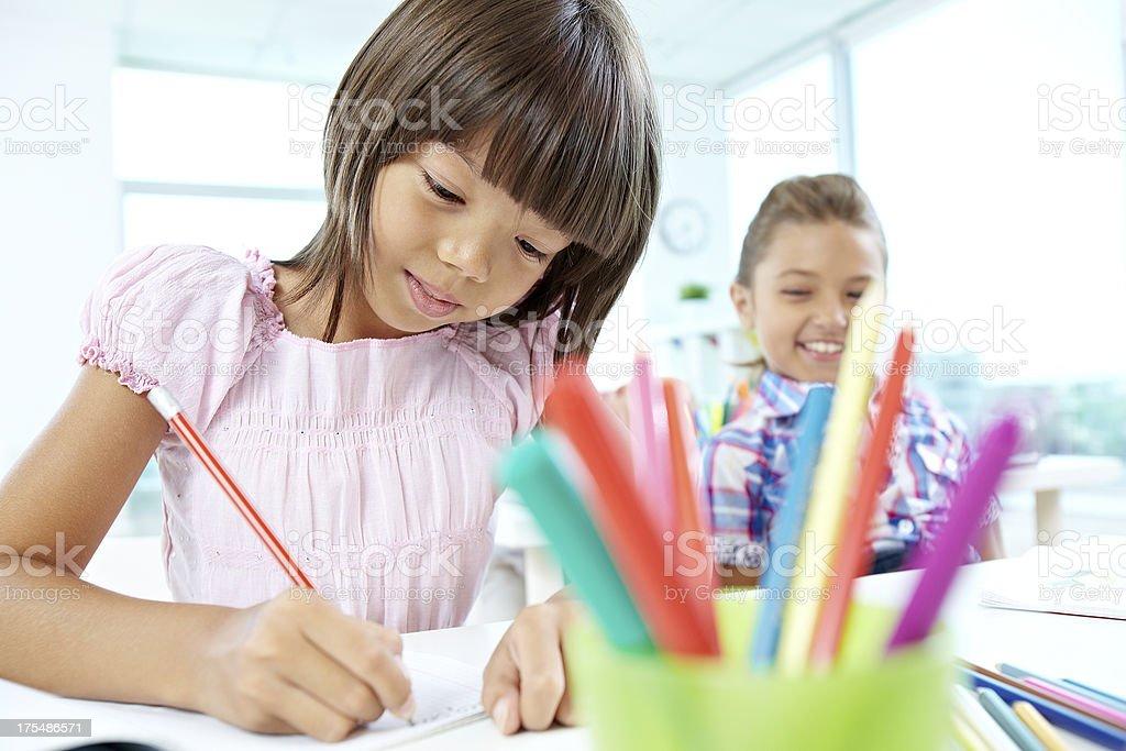 Girl drawing at preschool stock photo