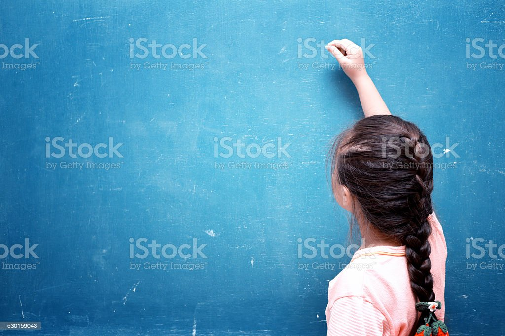 girl drawing on blank chalkboard stock photo