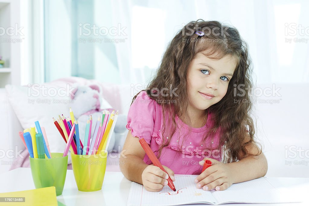 Girl drawing royalty-free stock photo