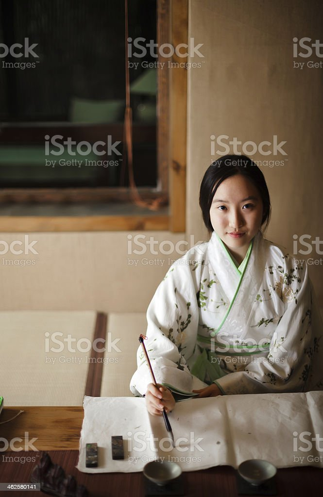 Girl drawing Traditional Chinese Painting stock photo