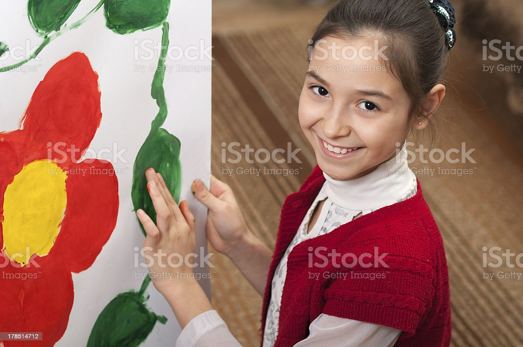 girl draws hands on paper stock photo