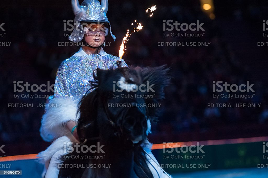 Girl dressed as a viking in show on Icelandic horses stock photo
