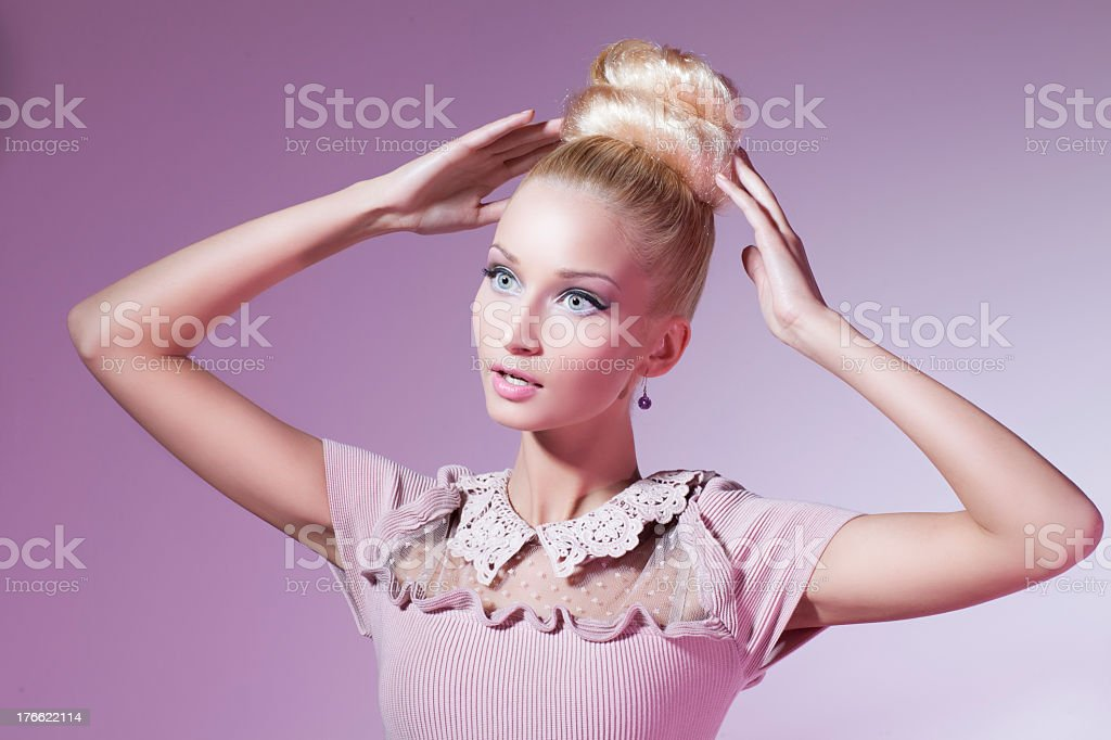 Girl dressed in pink looking like shop mannequin stock photo
