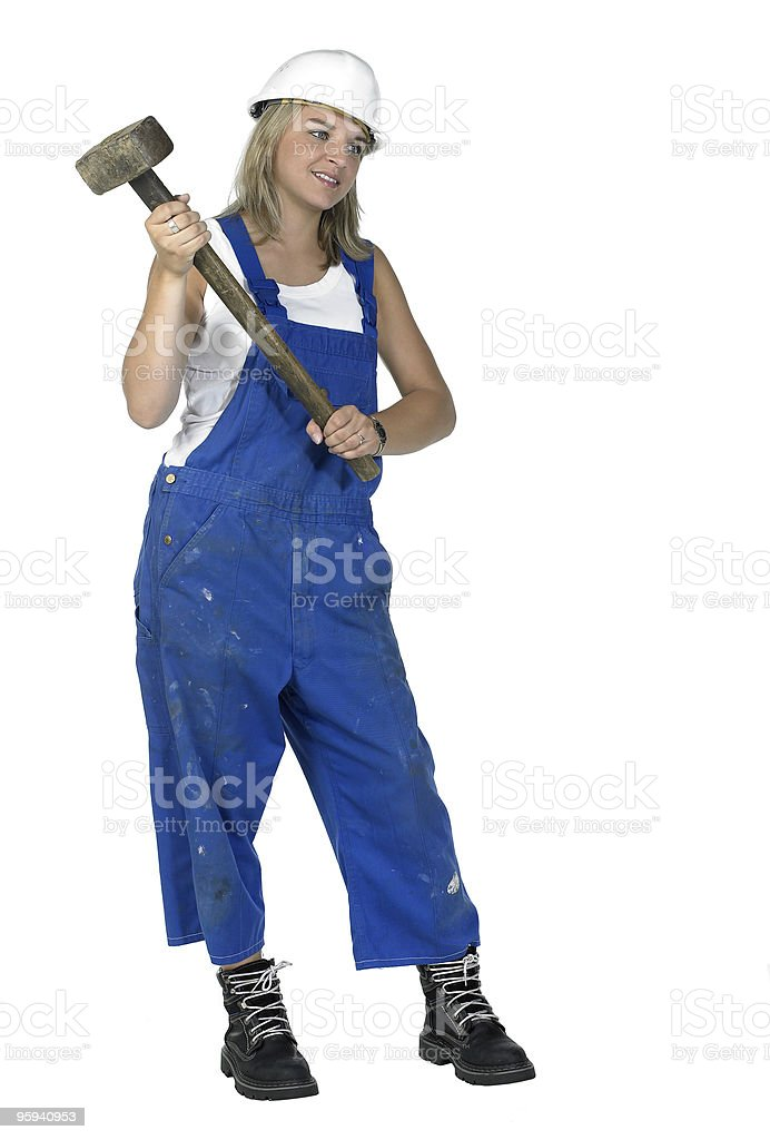 girl dressed in workwear holding a big hammer royalty-free stock photo