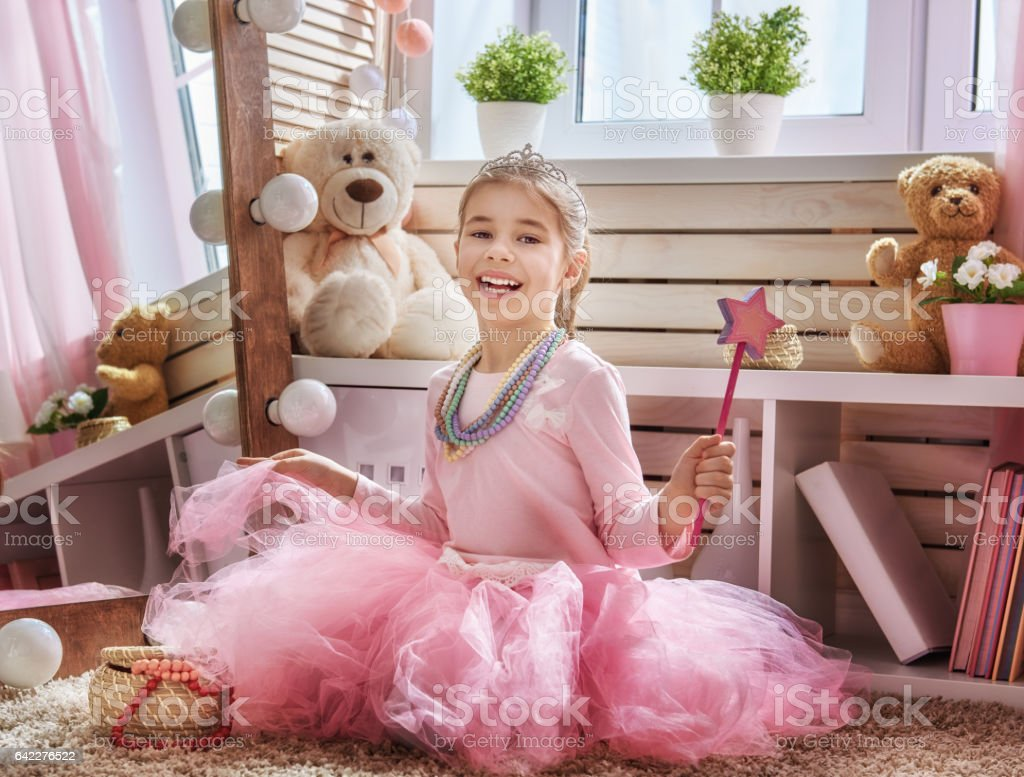 girl dresses up at home stock photo