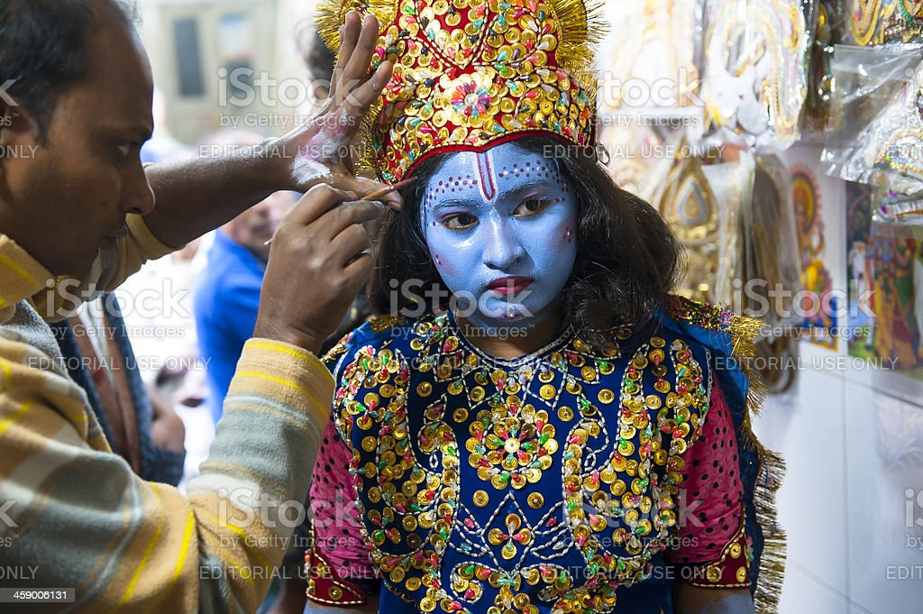Girl dressing and making up as Krishna in Old Dhaka stock photo