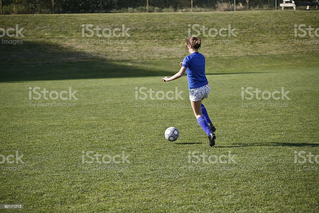 Girl Dribbling a Soccer Ball Before Match royalty-free stock photo