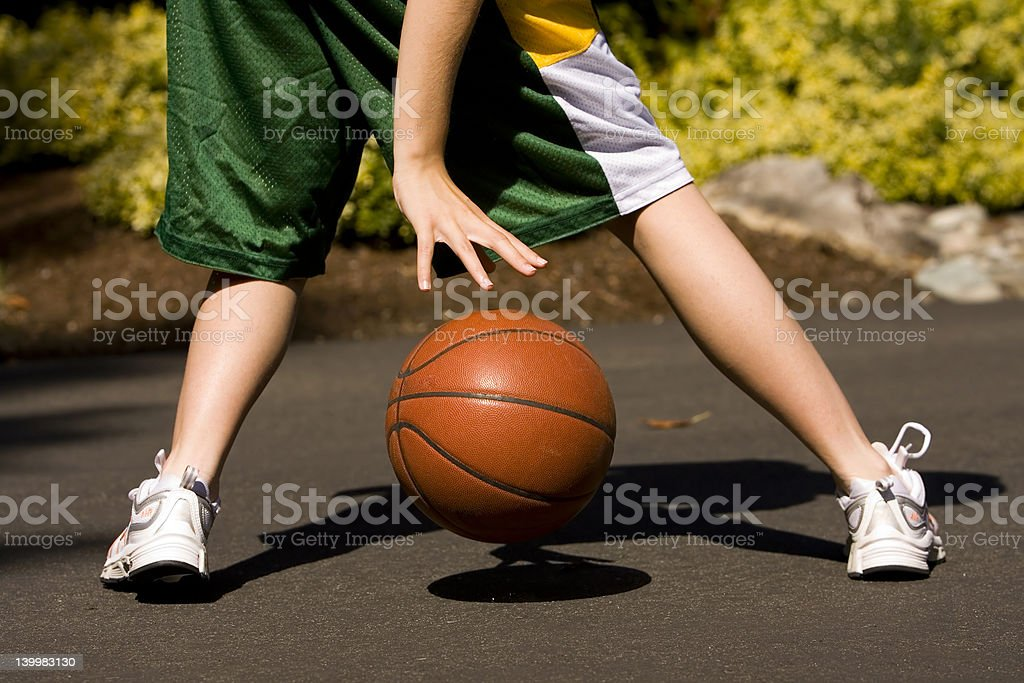Girl Dribbling Basketball stock photo