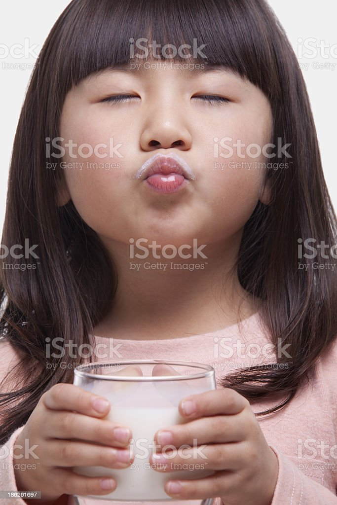 Girl drinking a glass of milk royalty-free stock photo