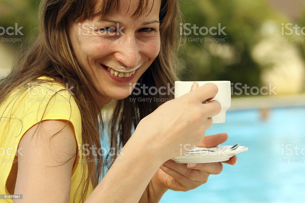 Girl drinking cappuccino royalty-free stock photo