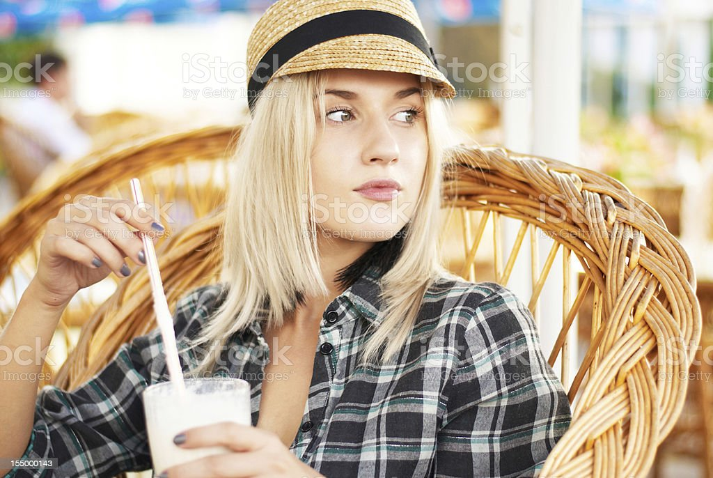 girl drinking cocktail in a cafe royalty-free stock photo