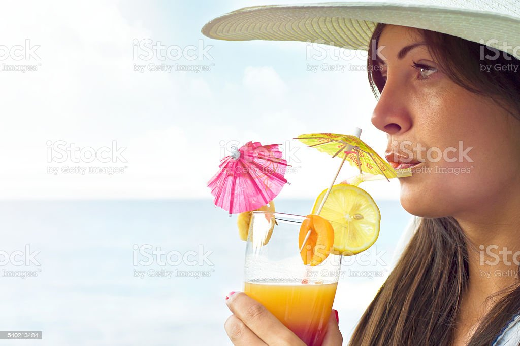Girl drinking cocktail outdoors stock photo