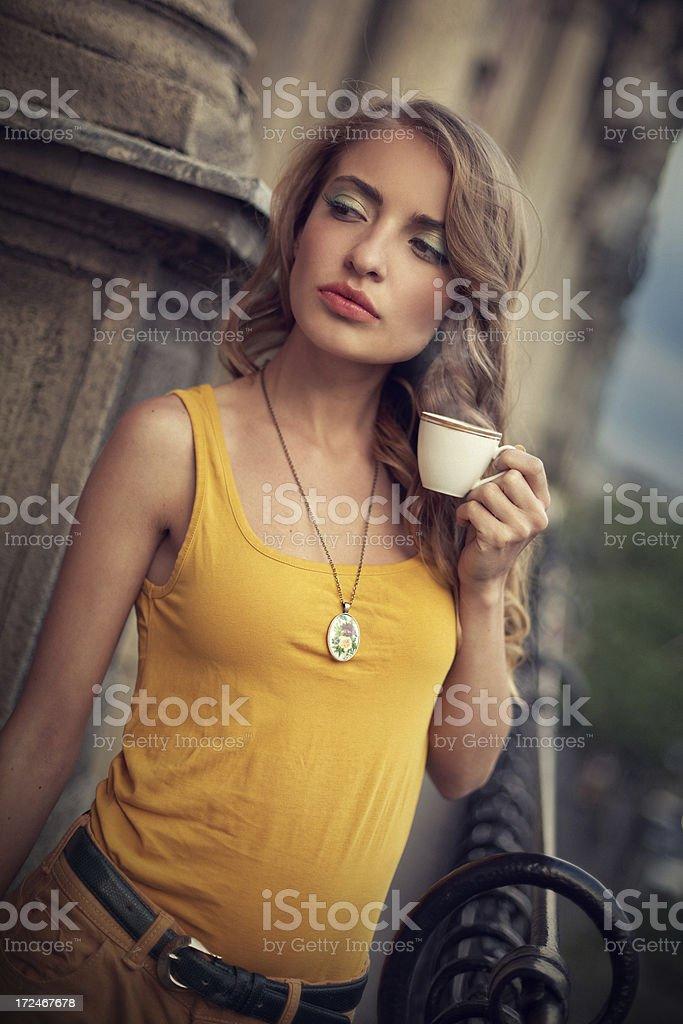 girl drinking coffee on the balcony royalty-free stock photo